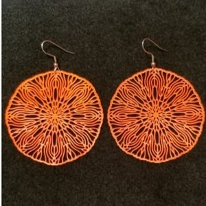Orange, metal lace, light earrings.